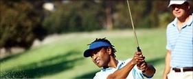 Tournament Golfer Teeing Off